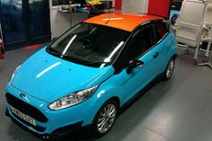 3M wrap course here @ Spandex wrapped in 3M 1080 sky blue gloss with orange roof.