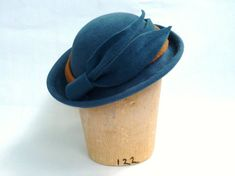 Vintage Style Hat- Bowler Hat Fascinator For Women- Handmde Chic Derby Style Millinery Hat in Dior Blue With Camel Accent. $139.00, via Etsy.