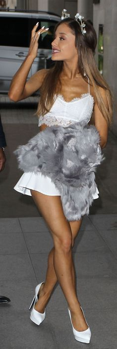 """Let's fix this caption: """"Ariana Grande wore a skimpy crop top and skirt"""