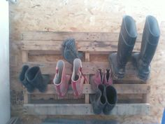 Part of a pallet turned into a Boot Rack!  Special thanks to KW for hanging it :)