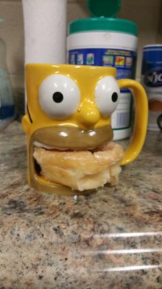My coworker's coffee mug holds a donut.