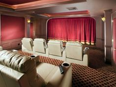 Amazing Home Theater Designs A traditional red velvet curtain gives this beautiful space an old Hollywood feel. The patterned carpet, columns and wood detailing also contribute to the classic look of the space. Copyright CEDIA Used with permission. Home Theater Setup, Best Home Theater, Home Theater Speakers, Home Theater Projectors, Home Theater Rooms, Home Theater Design, Home Theater Seating, Cinema Room, Movie Theater