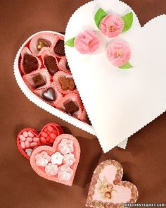 Give your valentine a heart-shaped candy box embellished with ribbon, shells, and handmade flowers.