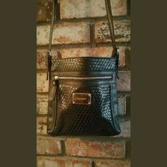 Nine West purse Black crossbody purse with weave pattern and zippered front. Very good condition. No holes rips or stains Nine West Bags Crossbody Bags