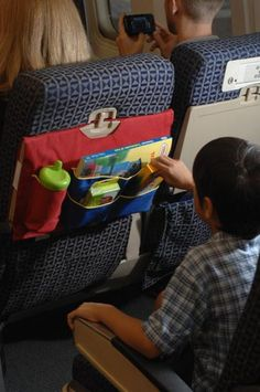 Airplane tray table cover with pockets.