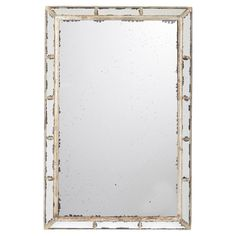 A wonderful mirror created from antiqued mirror glass, which is characterised by small black dots and uneven edges, and surrounded by a distressed, bronze-finished frame.
