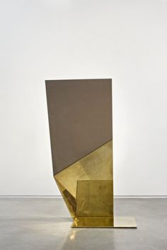 Mirror by London-based, Tanzanian-born British architect and designer David Adjaye (b.1966). Polished brass. via T magazine