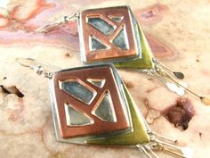 Copper, Brass, and Sterling Silver Dangle Earrings  http://www.artfire.com/ext/shop/product_view/dianesdangles/764533/copper__brass__and_sterling_silver_dangle_earrings/handmade/jewelry/earrings/metalsmithed#