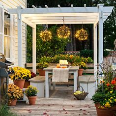 Delight in your deck throughout the fall. Create a cozy gathering spot in one corner by placing a DIY dining set under an easy-to-assemble pergola.