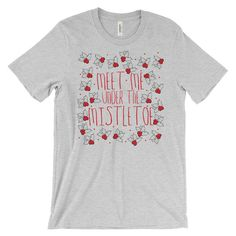 Meet Me Under the Mistletoe Unisex Christmas T-Shirt  This super-soft, baby-knit t-shirt looks great on both men and women – it fits like a well-loved favorite. Made from 100% cotton, except for heather colors, which contain polyester.  • 100% ring-spun cotton (heather colors contain polyester) • Baby-knit jersey • Shoulder-to-shoulder taping • Cover stitched and hemmed sleeves • Side-seamed