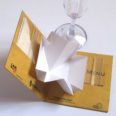 COMPACT DISH. Compact Dish is a reducible (cd size) and disposable tasting kit made by a dish, a glass, cutlery, napkin and menu. The closed set works like a coaster and with a simple action it magically becomes a set table ready for tasting