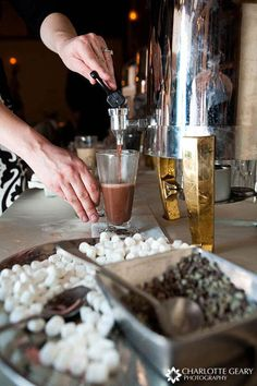 hot chocolate bar !!!  Great idea for cold winter notes around a bonfire!  For the adults, include Kahlua, Godiva liqueur, and chocolate flavored vodka.....yummmm