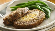 A meat-and-potato lovers' delight—tasty meat loaf stuffed with cheesy mashed potatoes!