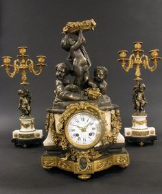 19TH C. BRONZE AND MARBLE CLOCK SET : Lot 62