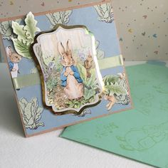 Made by Natalie Carrison - I made this card using the Peter Rabbit die cut toppers and papers. I've embellished the card using some die cut leaves from spellbinders and tattered lace. The envelope was decorated using the Peter Rabbit stamps. I love this little collection and will be making all my Easter cards for friends and family with it!