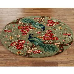 The wool Peacock Flora Round Rugs feature pops of vibrant colors perfect for your room. Round rugs, thick, have allover floral designs on a sage. Peacock Decor, Peacock Theme, Bohemian Living Rooms, Rugs In Living Room, Dark Green Rooms, Living Room Rug Placement, Feather Wall Art, Floral Area Rugs, Cool Rugs