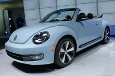 2013 Volkswagen Beetle TDI convertible shiny new beautiful bug. Daughter would love this!