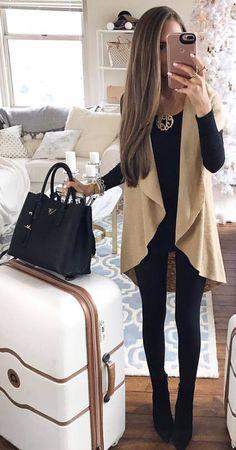 #winter #outfits black shirt, skinny pants, beige sleeveless coatee, boots