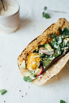 Mung bean + cilantro falafel tacos. A good excuse to try out mung beans if you are new to these! From Dolly and Oatmeal.