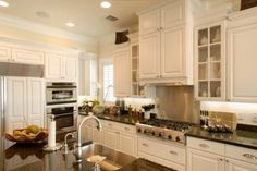 Off white walls with white cabinets style decor kitchen tropical with glass door cabinets off white walls stainless steel appliances white kitchen cabinets Off White Cabinets, White Kitchen Cabinets, Kitchen Cabinet Design, Kitchen Decor, Kitchen Ideas, Kitchen Photos, Kitchen Furniture, Kitchen Island, Nice Kitchen