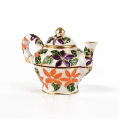 """""""Colorful Floral #Teapot Trinket Box Item No. KB00587A01 $20.29 Tea anyone? This floral Faberge style trinket box is constructed from a pewter base, then hand enameled and decorated with Austrian crystals. This teapot box is hinged and has a magnet for a clasp. The magnet enables the box to open easily, but close firmly. The box is great just for display, for holding or giving as a gift a small piece of jewelry, or for some of your memorable items. Jewelry Dresser, Jewelry Box, Boho Necklace, Crystal Necklace, Austrian Crystal, Vases Decor, Trinket Boxes, Tea Pots, Display"""