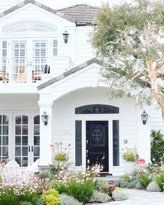Beautiful white traditional home exterior with arched transom window above front door, arched windows in French doors, and upper level balcony. Traditional Home Exteriors, Traditional House, Home Interior Design, Exterior Design, Exterior Paint, Colonial Exterior, Exterior Doors, Porches, House Goals