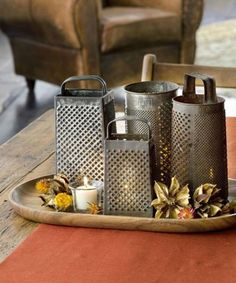 Say cheese — graters, that is. Salvaged shredders make a lovely table display with the illumination of votive candles twinkling through.