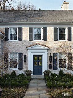 Shutters: Centuries ago, the shutters that distinguished many Colonial-style homes were operable, used to seal out inclement weather. Today's Colonials might still make use of this design element -- even if they're just for show -- to establish a regular exterior facade.