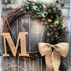 This large 24 inch peacock wreath is great for oversized doors. The wreath is embellished with dozens of natural peacock feathers, a burlap bow and a jute wrapped initial of your choice. Peacock Wreath, Feather Wreath, Peacock Decor, Feather Crafts, Peacock Feathers, Pheasant Feathers, Peacock Crafts, Peacock Theme, Monogram Wreath