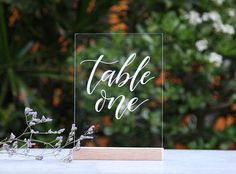 ### Please do not order from this listing - send me a message with your order requirements and postcode for shipping for a quote ### [ Acrylic Wedding Table Numbers ] Acrylic is the latest trend in weddings and events. Make your wedding truly unique with these hand-lettered place cards. [ Dimension, Colour + Pricing ] 148x210x2mm Black or white calligraphy | $9.50 148x210x2mm Gold or rose gold (copper) calligraphy | $10.50 **Wooden stands available for purchase from late June, 2017 [...