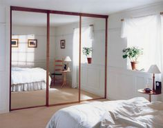 Endearing Bedroom Decoration With Various Sliding Bed Table : Epic Picture Of Modern White Bedroom Decoration Using Sliding Wooden Glass Mirror Closet Door Including White Pleat Bed Valance And Sliding Bed Table Without Headboard