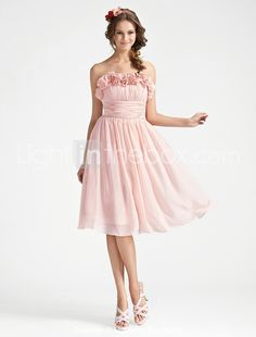 Super cute!! All chiffon... very expensive but a great site to look at for ideas/designs! love them! :D  A-line Strapless Knee-length Chiffon Bridesmaid Dress With Flower - US$ 99.99