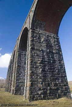 Ribblehead Viaduct in the Yorkshire Dales National Park, North Yorkshire, England - its 24 arches form part of the Settle to Carlisle railway line. Yorkshire England, Yorkshire Dales, North Yorkshire, Unique Buildings, Beautiful Buildings, Places To Travel, Places To See, Ribblehead Viaduct, Welcome To Yorkshire