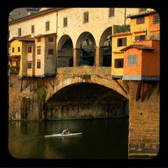 Rowing shell beneath the Ponte Vecchio, Florence, Italy, kayak, canoe bridge Arno river, yellow, orange ttv - Paddling in Time. $30.00, via Etsy.