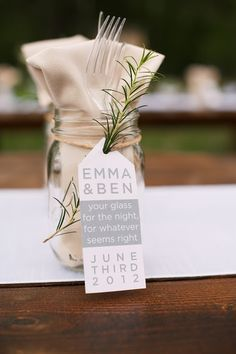 Place utensils and napkins inside a Mason jar (that guests can use as a drinking glass later!) for a casual wedding dinner place setting.