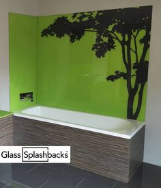 Bespoke glass bath splashback. Have you ever considered designing your own splashback from start to finish? This modern look was achieved by sandblasting two sleek stripes into the glass, then using a contrasting colour. If you are a bit creative, and want something that is totally unique, why not contact us by clicking the link below? Our creative team will work with you to create a design completely to your specification. http://glasssplashbacks.com/index.php/711-2/