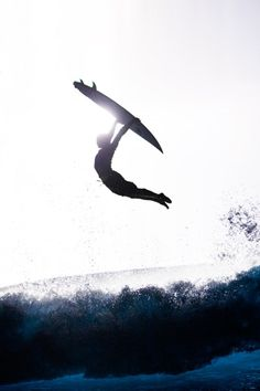 Swan dive with surfboard