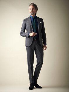 Charcoal grey suit, denim shirt, green tie