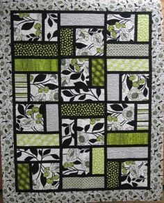 I wonder if you could sub a tee shirt in the big square for a t-shirt quilt? DeNovo Quilt... simple but I love this!