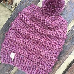 A super soft chunky knit beanie with purled stripes and a cute pompom.