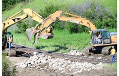 A crew works repairing a washed out rail line west of Balcarres just of the number 10 highway July 3, 2014 B