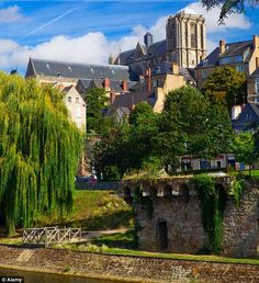 Le Mans, a city in France, located on the picturesque Sarthe River. | Learn more about the beautiful places in France by checking out the Travel section of Talkinfrench.com https://www.talkinfrench.com/tag/french-tourism/ Get your copy of the best French phrasebook available in the market today: Talk in French's Phrasebook will help you travel in France with confidence. https://store.talkinfrench.com/product/french-phrasebook/