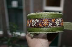 Flowery green brocade collar.