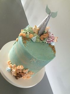 Buttercream mermaid cake, ice cream cone tail, meringue conch shells, gold chocolate seahorsees, cookie starfish, watercolour effect buttercream scrape, and on the INSIDE... malibu drizzle sponge, raspberry and vanilla buttercream :-)