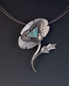 Pendant   W. Walsh. Sterling silver and an Australian boulder opal