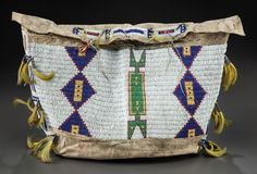 American Indian Art:Beadwork and Quillwork, A SIOUX BEADED HIDE TIPI BAG. c. 1885