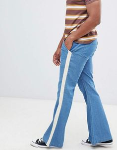 Shop Sacred Hawk flared jeans with side stripe at ASOS. Flare Jeans Outfit, Funky Outfits, Jean Outfits, Latest Mens Fashion, Fashion Online, Latest Clothes For Men, Loose Jeans, Striped Jeans, Bell Bottom Jeans