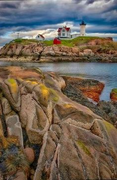 """Nubble Lighthouse"" by Alan Borror on - This lighthouse is in Cape Neddick, Maine just north of York, Maine. it is on an island and there is no public access. The sky was a mixture of both bright and dark clouds. Nebraska, Oklahoma, Cape Neddick Maine, The Places Youll Go, Places To See, Wyoming, Puerto Rico, Maine Lighthouses, Lighthouse Pictures"