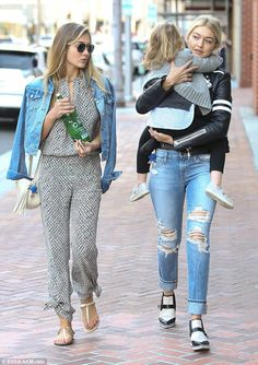 She's not tired: Gigi showed no signs of fatigue as she continued on her way carrying the ...