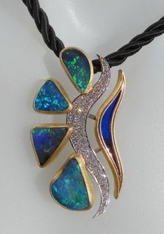 Award Winning: Poseidon is a handcrafted pendant made up of five beautifully matched Quilpie blue green opals that inspired Leon to design and make Poseidon after seeing the wonderful deep blue green colours of Boulder Opal.